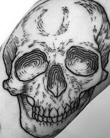 череп на предплечье тату