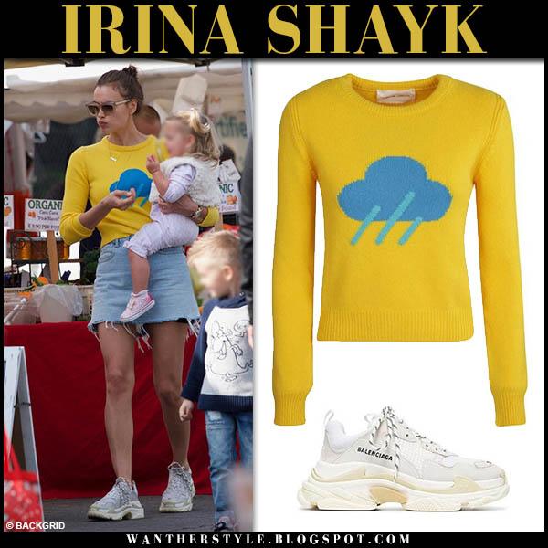 Irina Shayk in yellow knit alberta ferretti sweater, denim skirt and balenciaga sneakers model casual style december 2018