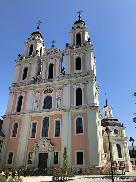 Pastel coloured facade of Baroque style Saint Catherine's Church in Vilnius in Lithuania
