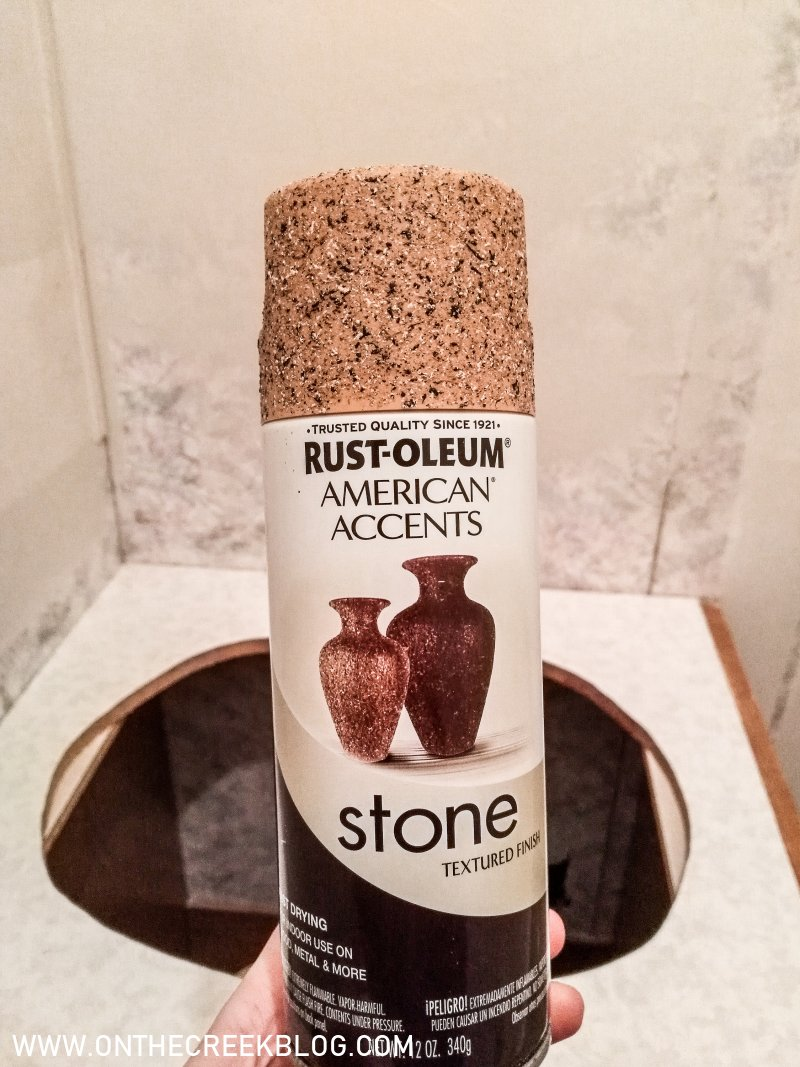spray painted bathroom laminate countertops using rust-oleum american accents textured spray paint!