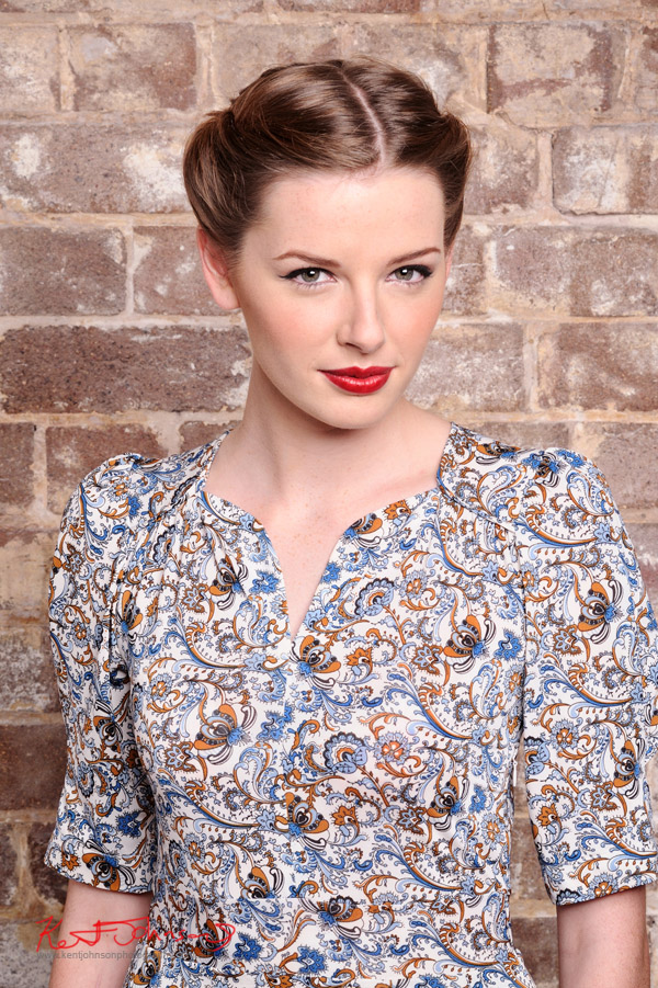 Vintage fashion, paisley dress photographed against a distressed brick wall in the studio - studio fashion photography