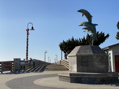 dolphin statue at pier entrance in Cayucos, California