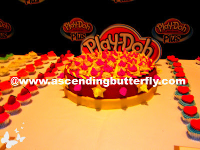 Play-Doh Plus used to create mini Play-Doh Cupcakes table display at Hasbro Toy Fair 2013 Event in New York City