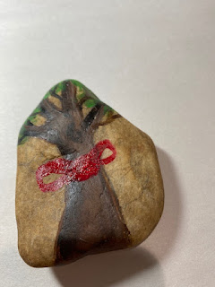 red ribbon of hope rock