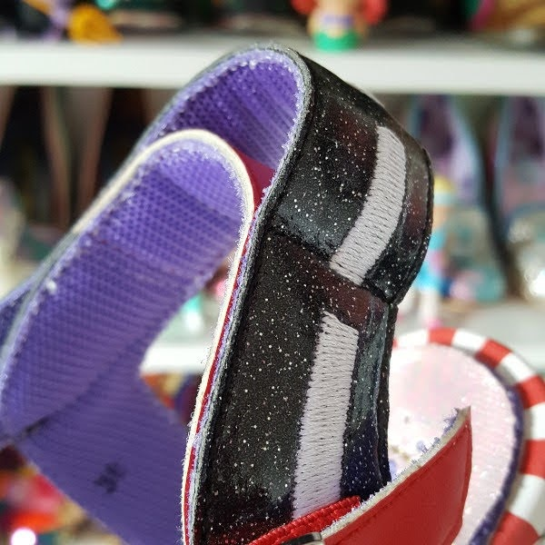 close up of double strap feature at heel of sandal