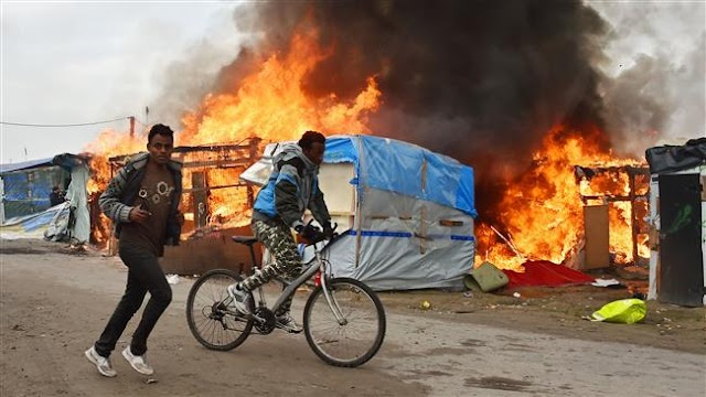 Massive fires rage across French refugee camp in Calais amid evacuation
