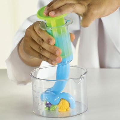Beaker Creatures Alien Slime - boy pouring slime through scientific equipment onto beaker creature aliens