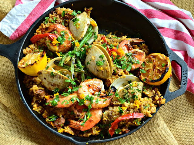 Seafood Paella is an impressive dish but so easy to make! Seafood lover's take note! www.thisishowicook.com #paella #seafoodrecipes