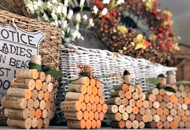 Wine cork pumpkins on shelf with baskets