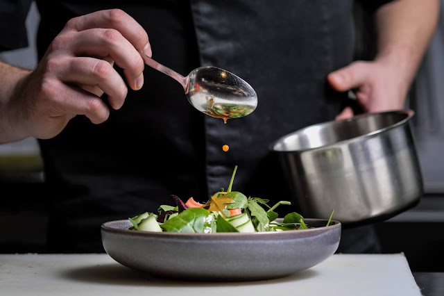chef decorating salad