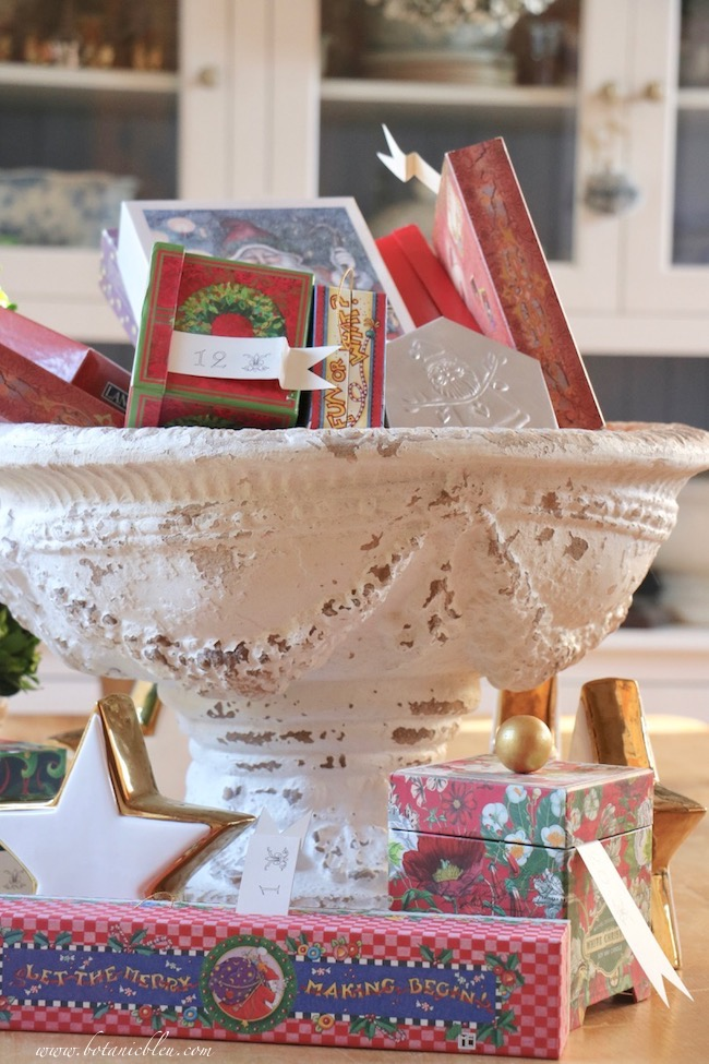 Not too late for Advent calendar Christmas boxes in a large urn on the dining table