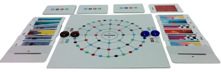 A game of ...and then we held hands, ready to begin. The board is in the centre, made up of three concentric rings made up of dots in blue, green, black, and red. On each side is a five-space sliding scale of negative two to positive two. There is a red glass bead on the centre space of the left scale, with another red bead on the space of the outermost ring closest to that scale. Two blue beads are arranged in a similar fashion on the right side. On both the right and left side are six emotion cards, each of which covers half of the card below it, and the top card half-covered by a plain white and grey cover card. On the far side of the board are three stacks of eight goal cards, with one card turned face up next to the first stack to show the red 'anger' icon.