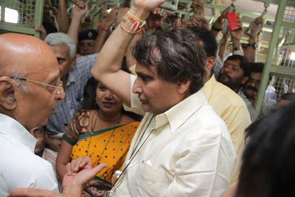 Railway Minister Suresh Prabhu surprised Mumbai commuters by travelling in a 'local' train on Thursday.   He had gone to an event at Central Railway's Matunga Workshop. From there he boarded a local train at Currey Road station and alighted at the Chhatrapati Shivaji Terminus (CST).