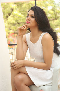 Sakshi Choudhary Looks super cute elegant and Enchanting in a Cute Small Sleeveless White Dress