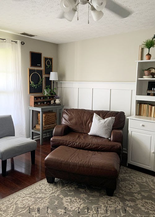 Spring Home Tour - living room with brown chair, board and batten,  and chalkboards.