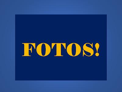 A imagem representa um quadro de fotografia e no centro da imagem está escrito a palavra: Fotos!