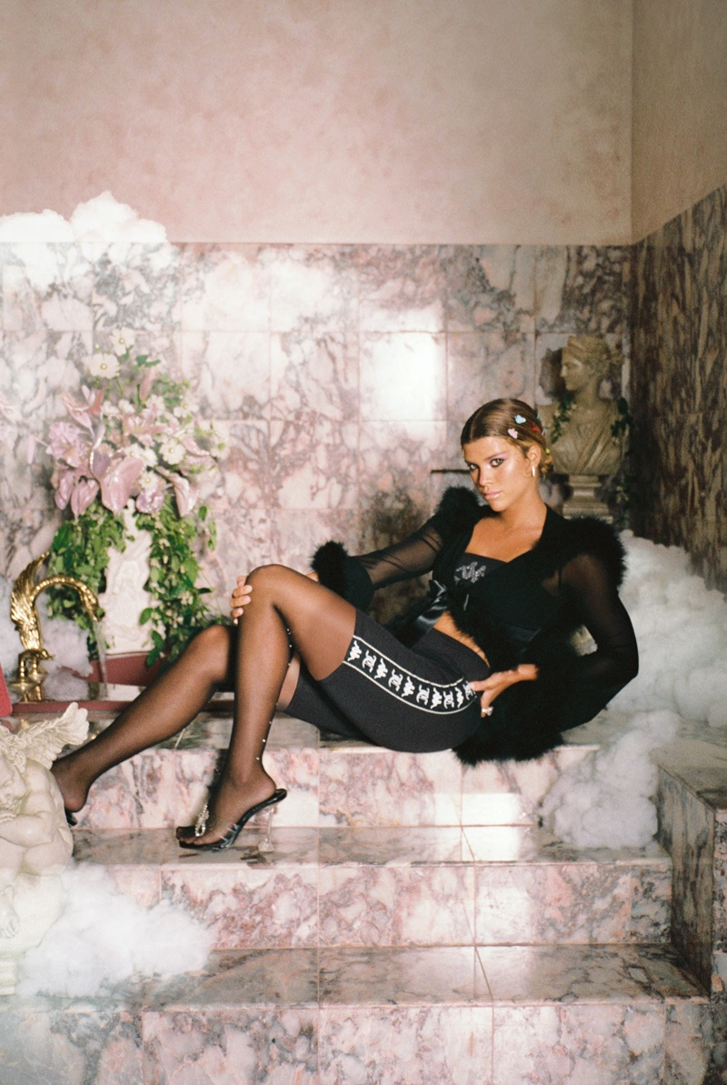 Dressed in black, Sofia Richie poses for Kappa x Juicy Couture campaign.