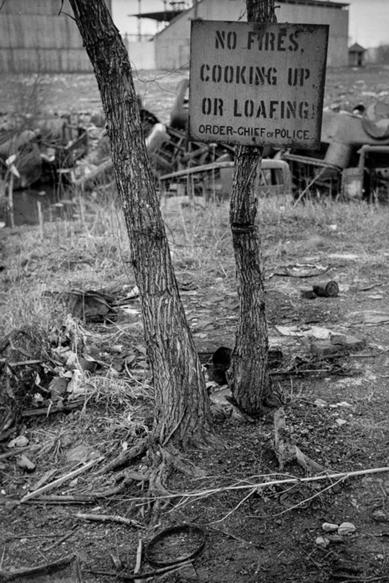 A sign in the river bottoms shacktown in Dubuque. 1940.