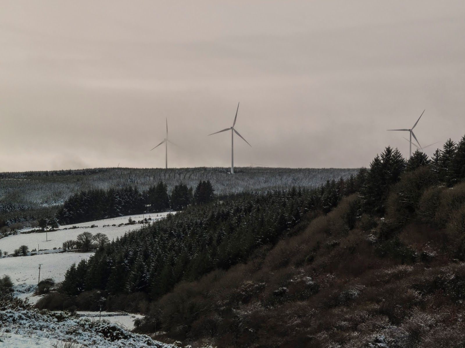 Snow dusted landscape of windmills on a mountaintop in North Cork.