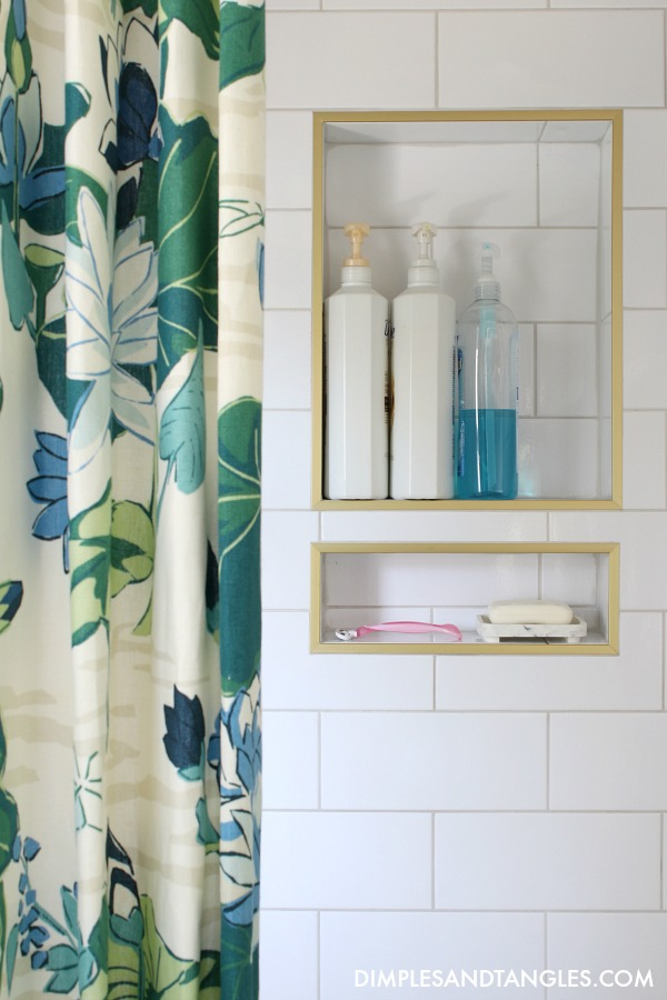 brass Schluter Trim for shower, oversized white subway tile, madcap cottage lake agawam