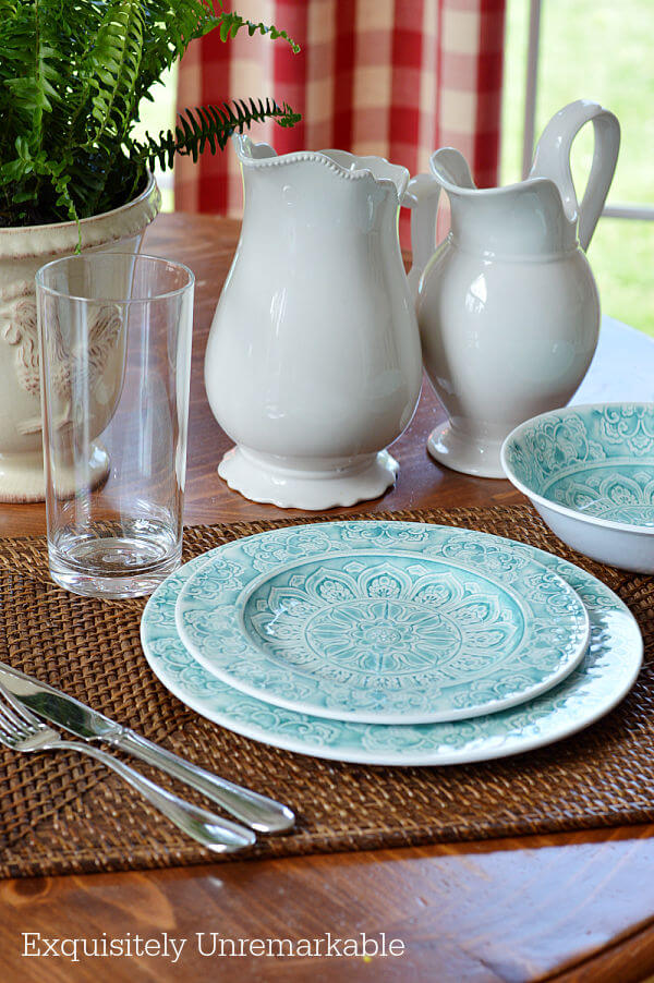Teal melamine outdoor dishes on a table