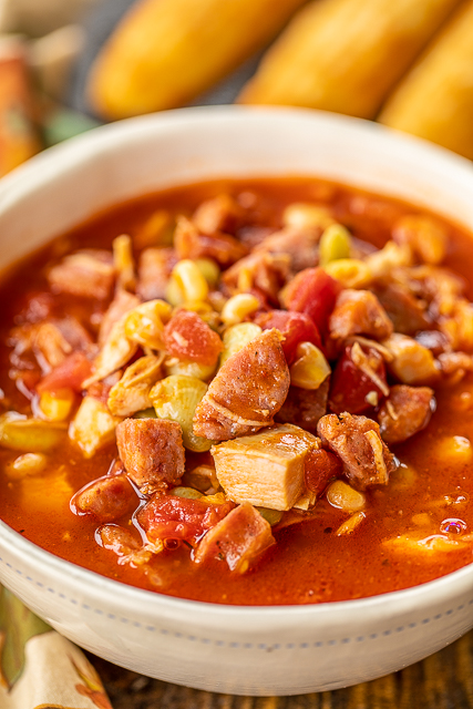 Smoked Sausage & Turkey Brunswick Stew - ready in 20 minutes! Smoked sausage, turkey, lima beans, corn, chicken broth, BBQ sauce, tomato sauce - throw in the pot, bring to a boil and simmer for a few minutes. SO delicious! Great way to use up leftover holiday turkey!! We made this two weeks in a row. We couldn't get enough of it! YUM! Freeze leftovers for a quick meal later! YUM! #soup #stew #leftoverturkey #turkey #quick