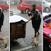 A dog helps his man to sell even though they are both wet from the rain