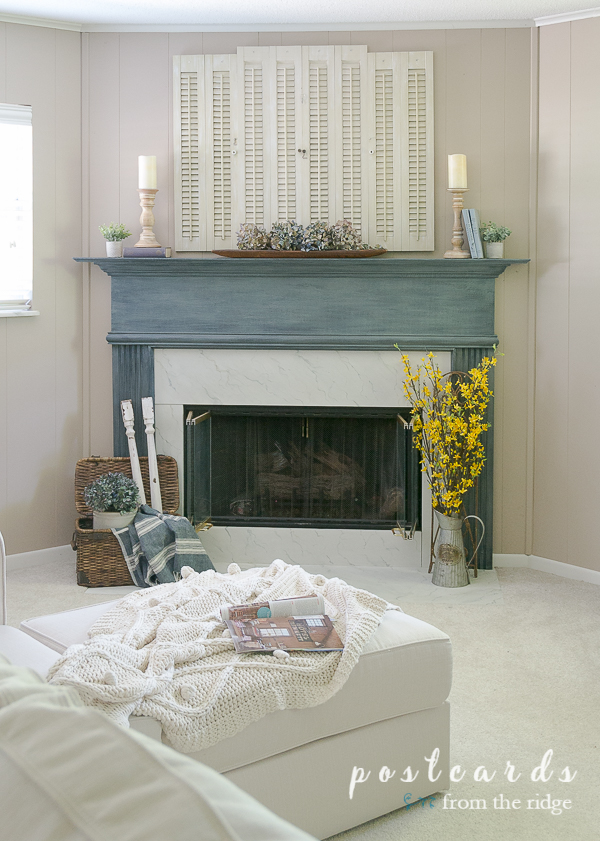 blue mantel with salvaged shutters and vintage decor