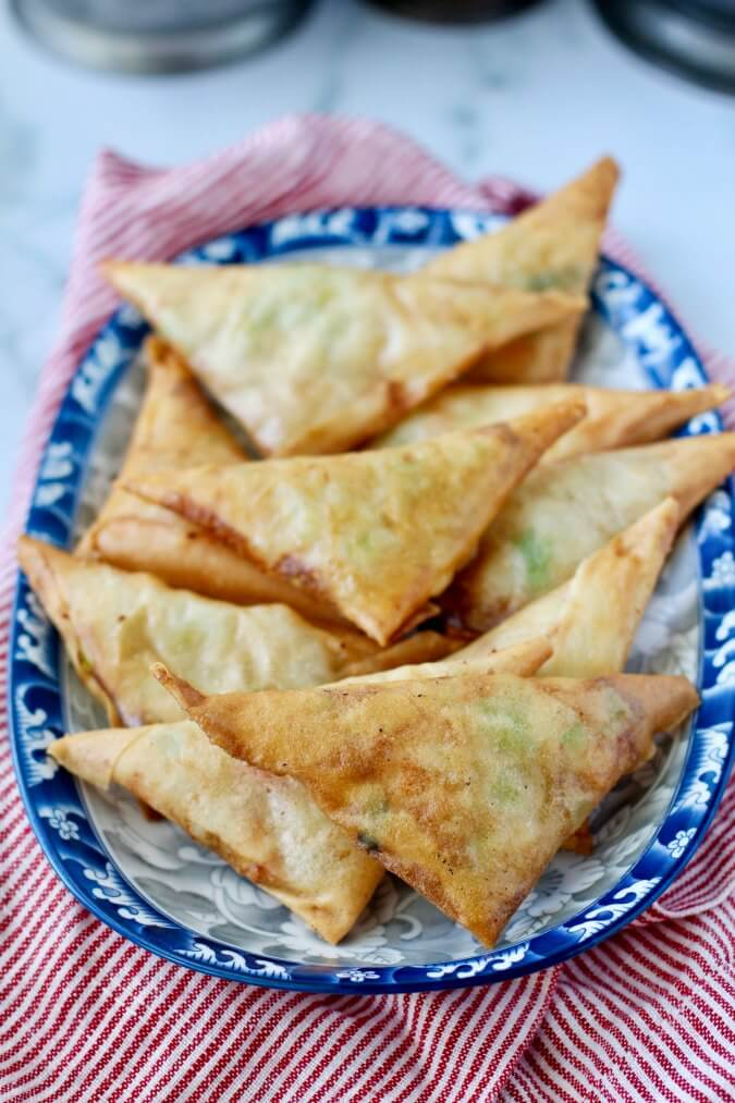 Shrimp spring rolls shaped into triangles
