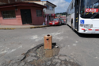 Large pothole on street in Puriscal.