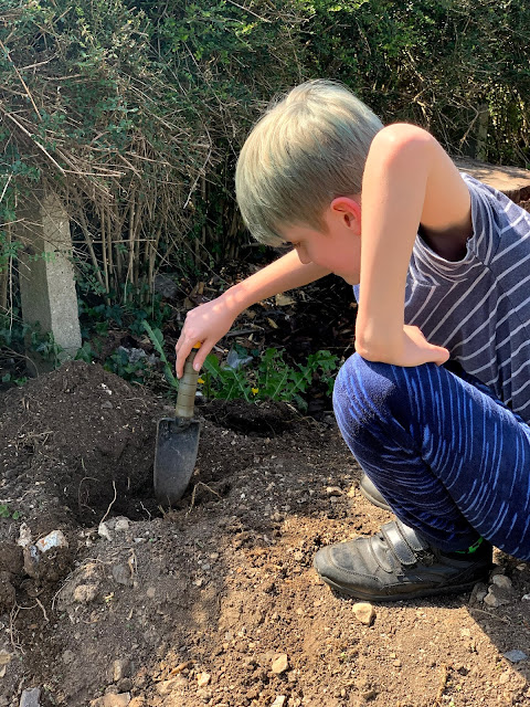 child digging