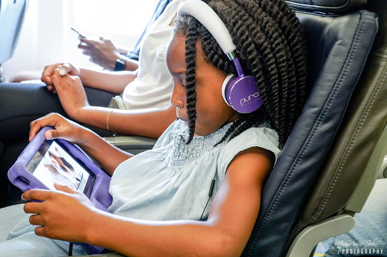 Child Wearing Headphones Showing Proper Travel Etiquette