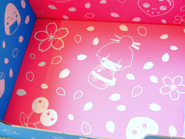 A photo showing the inside of a box decorated with cute Japanese-themed illustrations