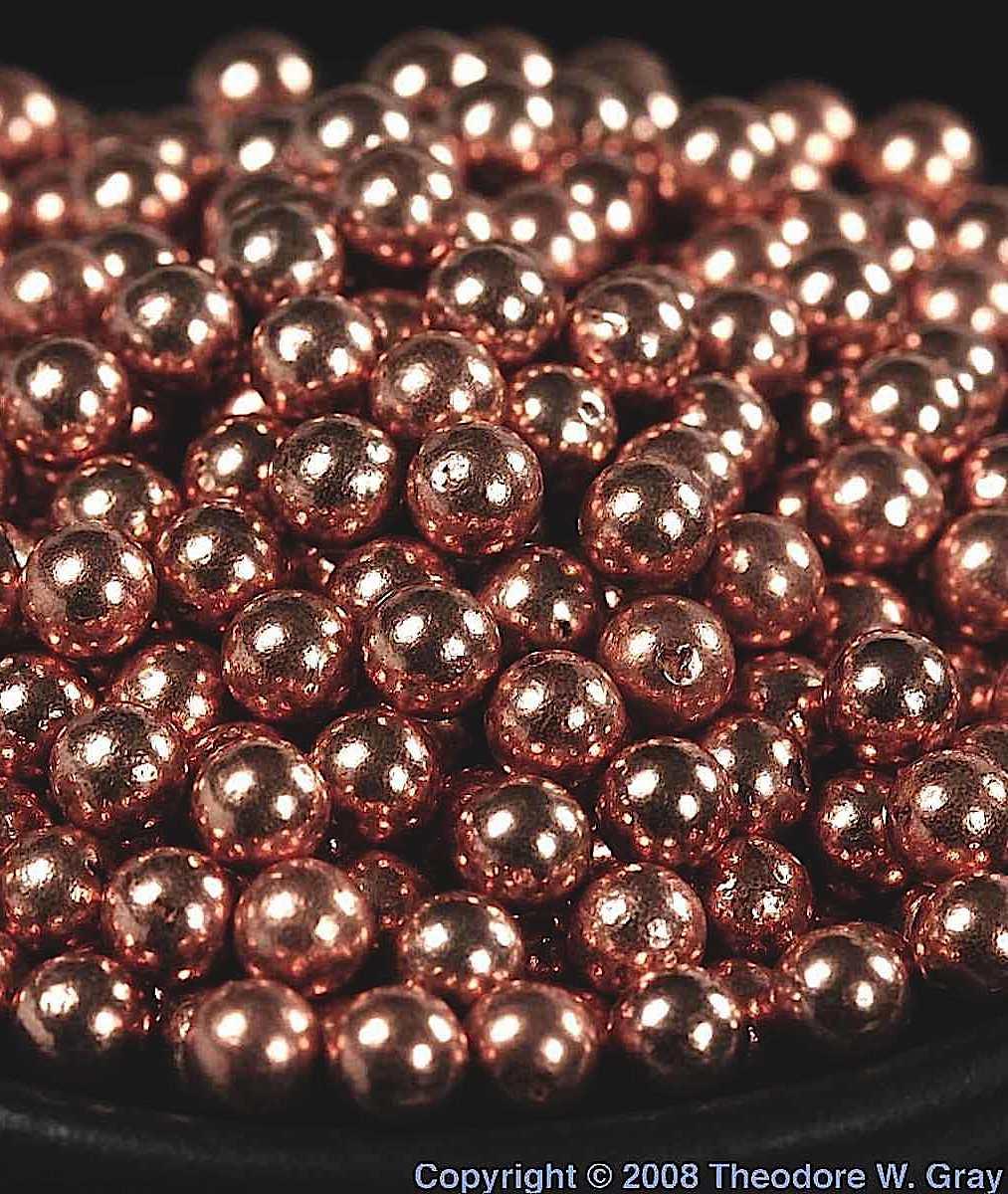 copper BBs, a color photograph close up macro