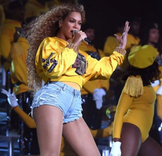 Beyonce on stage in college themed outfit