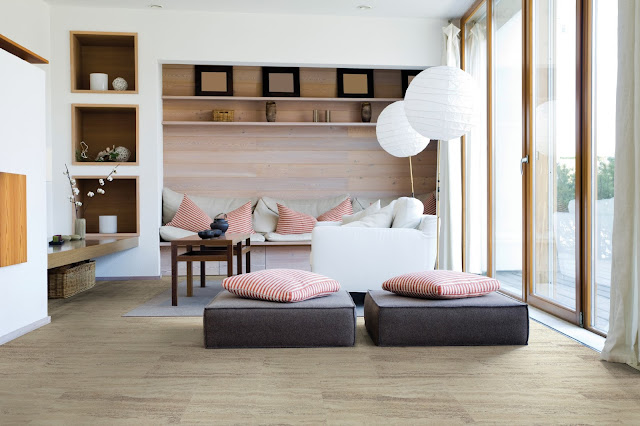 Even busy rooms can have the look of wood floors with tile or luxury vinyl floors