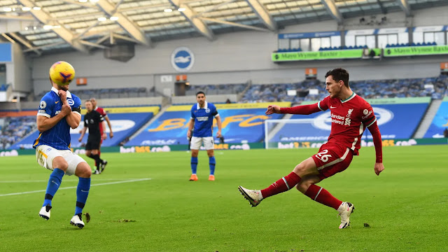 Liverpool defender Andy Robertson crosses the ball against Brighton