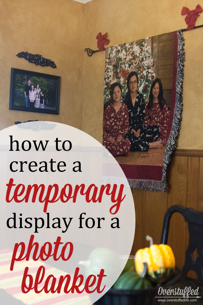 Have a decorative blanket or quilt you only want to display seasonally? Here's a super easy tutorial for a temporary wall display. #overstuffedlife