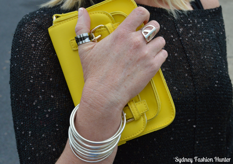 Black Sequin Sweater, Yellow Cross Body Bag, Silver Bangle Stack, Silver Peace Ring, Black & Silver Interlocking Ring