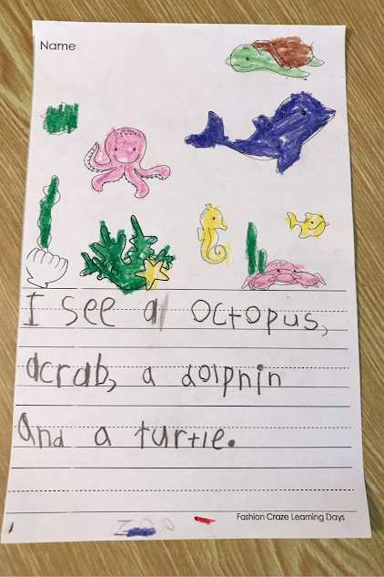 Kindergarten students write sentences to match the pictures they see