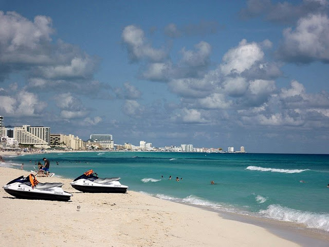 a view of the beautiful coastline,jet ski, sand wave on the Cancun beaches