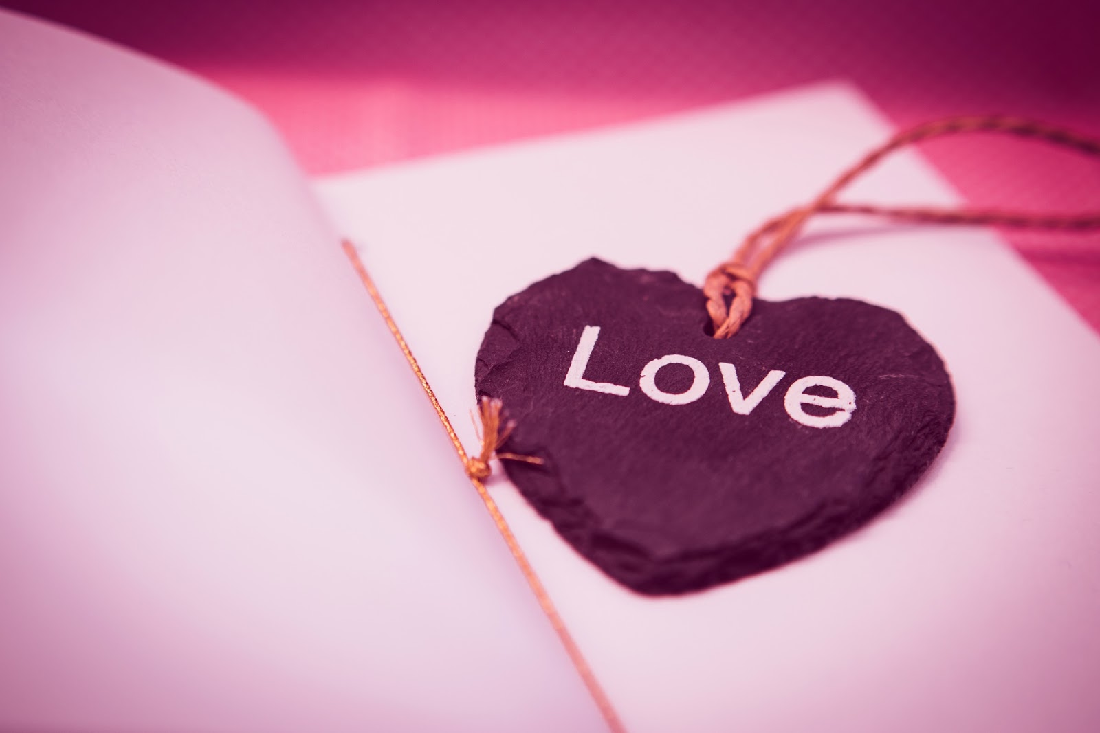 Heart shaped bookmark inscribed with the word love