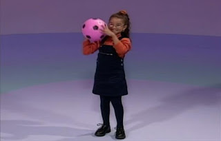 a little girl catches a ball and throws it back. Elmo's World Balls Kids and Baby