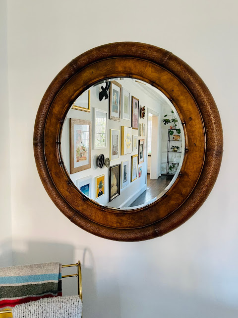 Large wooden-framed circular mirror
