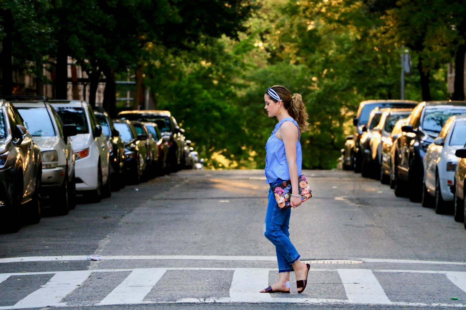 Nyc fashion blogger Kathleen Harper wearing a polka dot ruffle top and jeans.