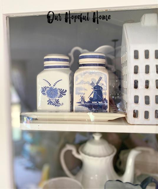 glass door corner cabinet ironstone Delft blue canisters