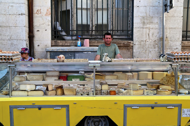 cheesemonger at Sète market, South of France