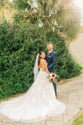 groom and bride with long floral detailed dress