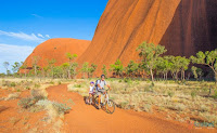 Flying, riding & cycle to explore Uluru