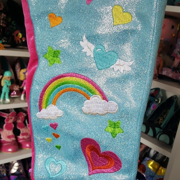 close up of stars, hearts and rainbow embroidery on boot uppers